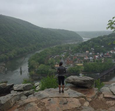 A hiker looks out over Harpers Ferry