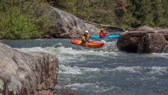 kayakers paddle down the Upper Big Sandy Creek