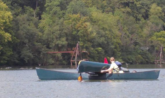 A T-rescue is performed on a canoe