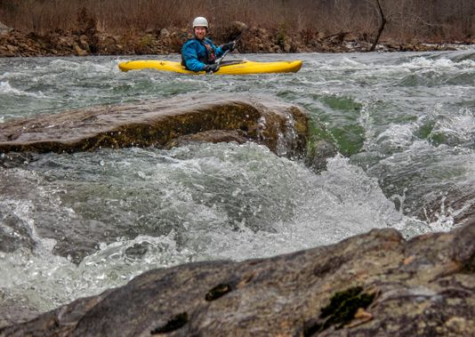 A kayaker prepares to enter a rapid on the Cherry River