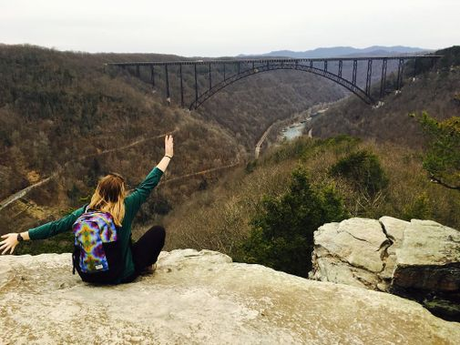 An individual revels in the view of the New River Gorge Bridge
