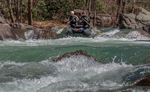 A Shredder goes over a small drop on the Buckhannon River
