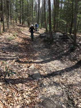 Mountain bikers ride the Rhododendron Trail at Coopers Rock