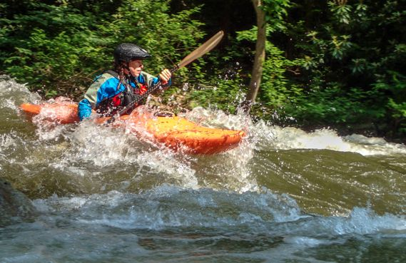 A kayaker paddles on the Savage River
