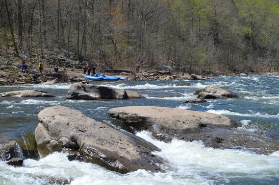 Rafts pull off the side of the river to scout