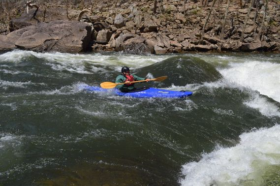 A kayaker approaches the main drop of Calamity Rapid