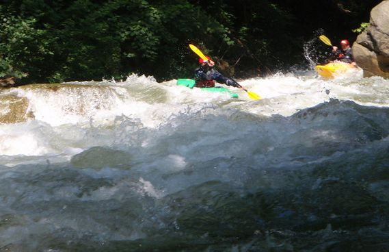 Two kayakers paddling down a Savage River rapid