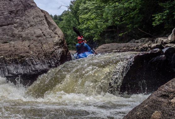 A kayaker prepares to launch over the drop on the Top Yough