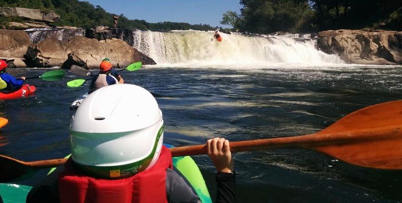 Kayakers watch as one goes over Ohiopyle Falls