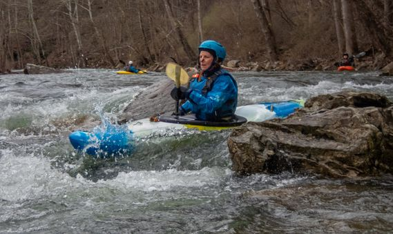 A kayaker paddles through a rapid on the Cherry River