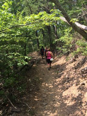 Hikers climb a steep trail near Seneca Rocks