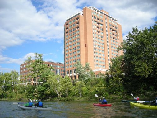 Kayaks float below the Waterfront Hotel on the Monongahela River