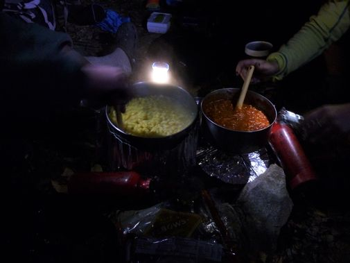 Cooking dinner on backpacking stoves
