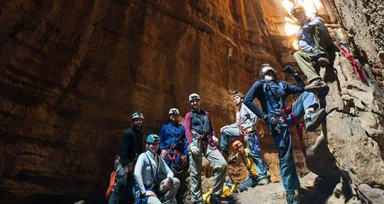 A group of cavers poses for a picture