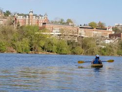 A kayaker paddles on the Mon. River in downtown Morgantown