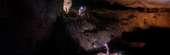 Two people exploring a cave in WV.