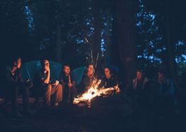 Campers setting around a campfire