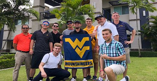 Students displaying the WVU flag in the Dominican Republic