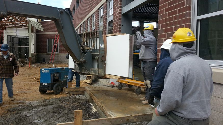 Engineers working at the elementary construction site