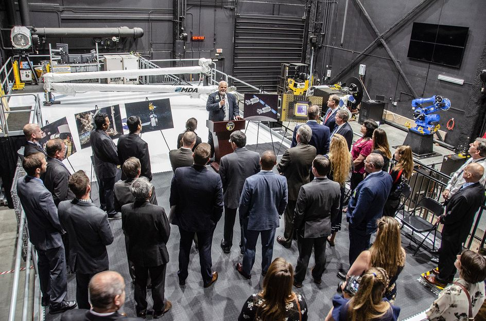 Gene Cilento speaks to a crowd at the West Virginia Robotic Technology Center
