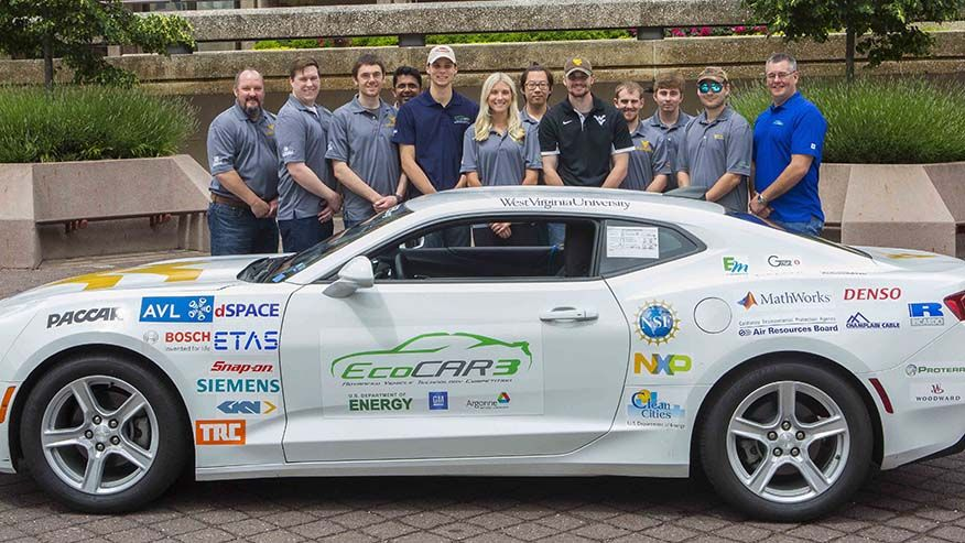 A photo of the EcoCAR 3 team with the Camaro.