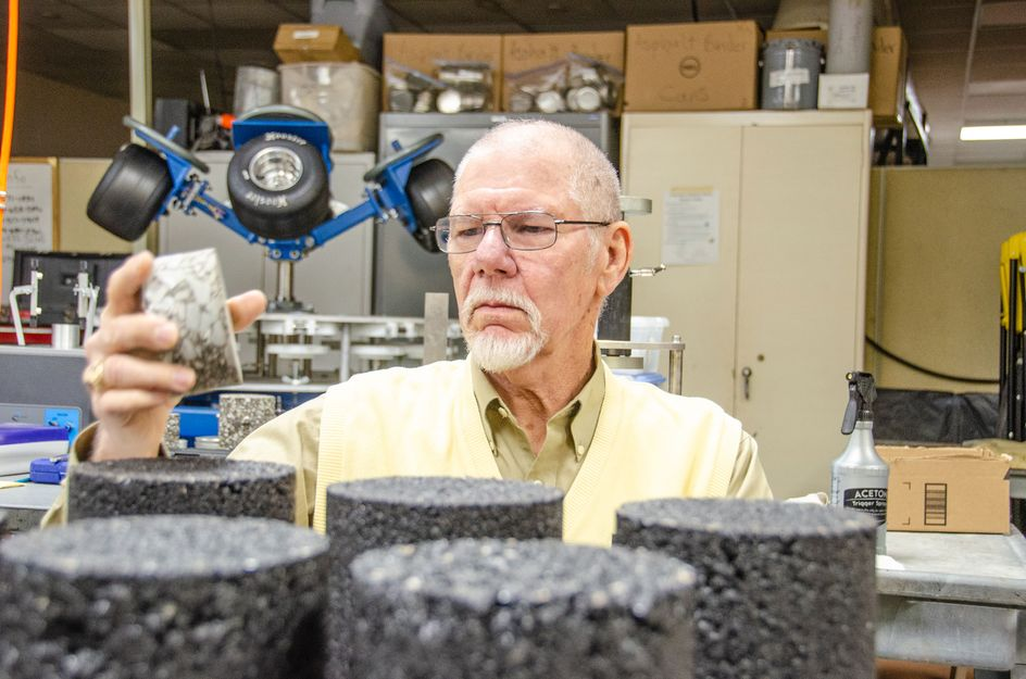 John Zaniewski reviewing asphalt samples in his lab.