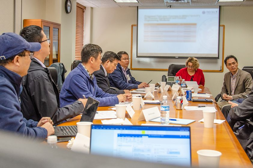 Visitors from the China University of Mining and Technology meet with representatives from the Statler College to discuss new master's program.