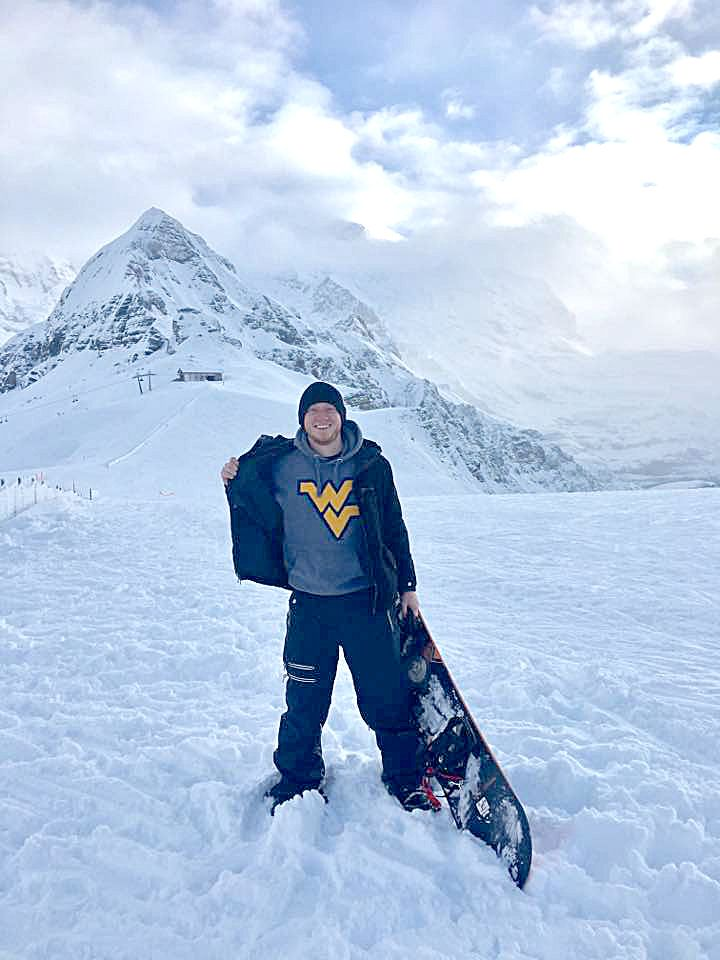 A photo of Tyler Hartman atop Switzerland's Jungfrau Mountain.