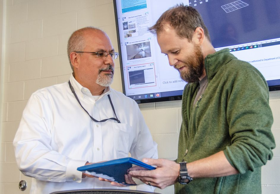 John Fiore awards Patrick Browning with research award from U.S. Navy