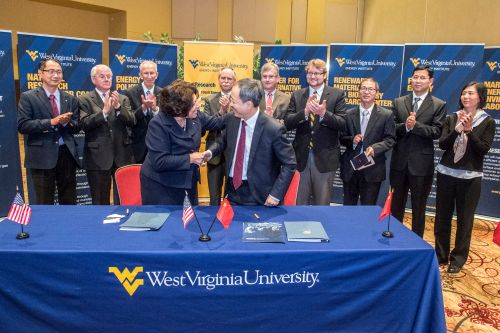 (WVU Photo by Brian Persinger) -- Provost Joyce McConnell shakes hands with Wang Shumin, senior vice president, Shenhua Energy Company, at a signing ceremony in Morgantown, West Virginia.