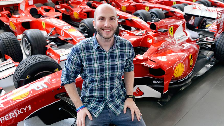 Nicco Campriani sits on the wheel of an the Shell Company F1 racer