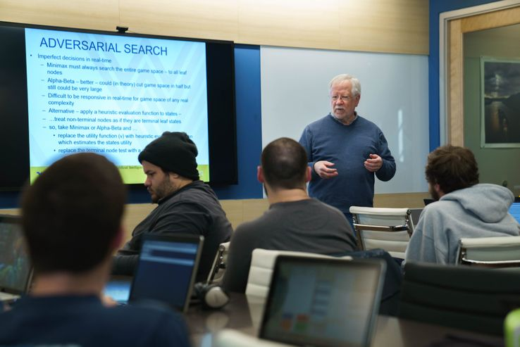 A photo of Research Associate Don McLaughlin lecturing to a computer science class.