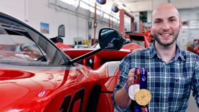 Nicco Campriani beside the Ferrari F1 Racer, showing off his metals