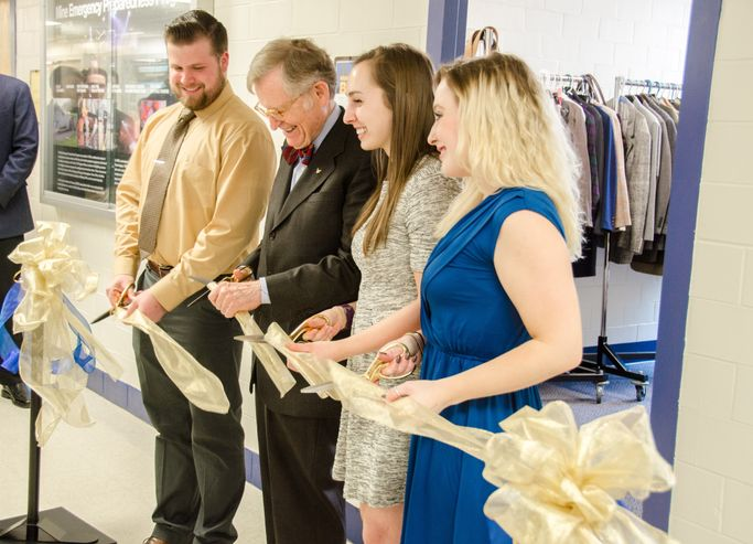 A photo of career closet ribbon cutting
