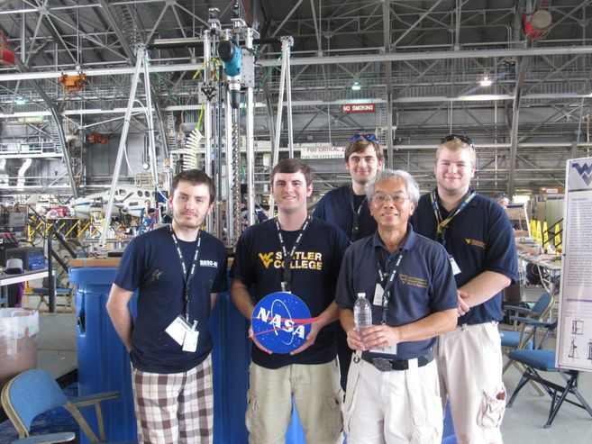 A picture of the MIDAS team in front of their robot.