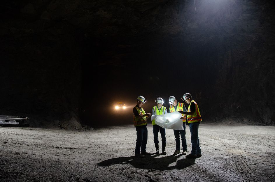 Berk Tulu studies a map with personnel from Laurel Aggregates, a large surface and underground limestone quarry near Morgantown.