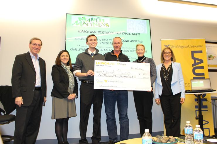 A picture of William Keefe receiving his check
