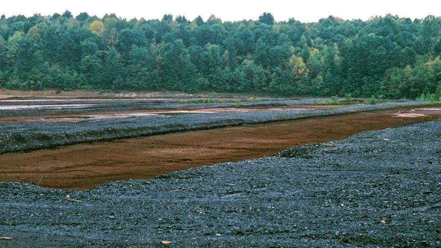 An image of coal mining waste in a field located in Upshire County, West Virginia