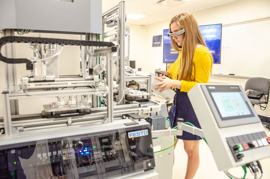 Female working at an advanced manufacturing system with virtual glasses.