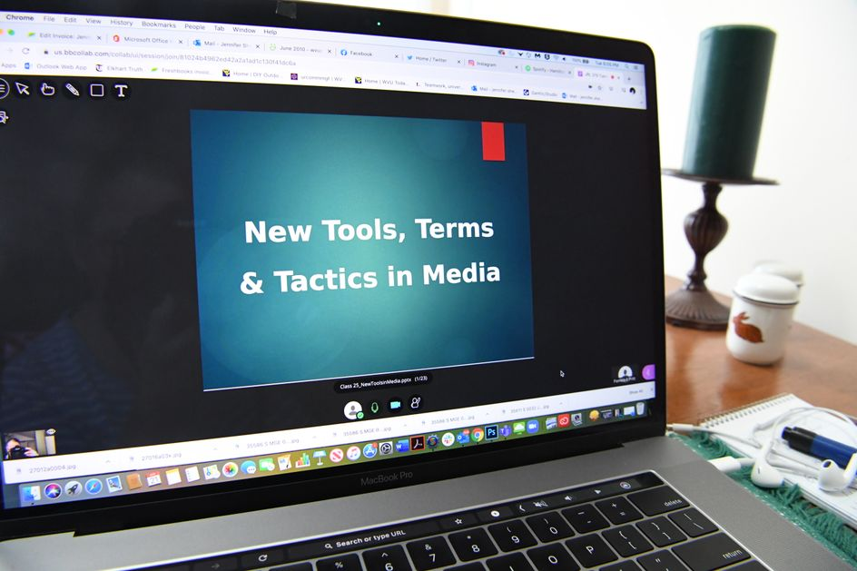 "A computer screen with a power point slide that reads, ""New Tools, Terms and Tactics in Media"""