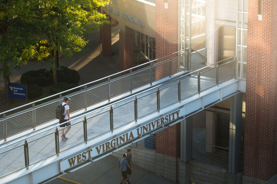 Student walks across the B&E footbridge after a day of class.