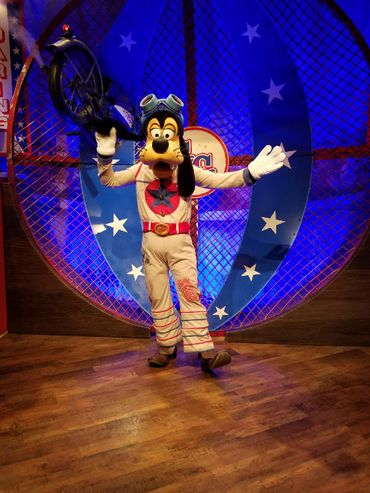 A photo of Benjamin Twiest in a Disney dog costume.