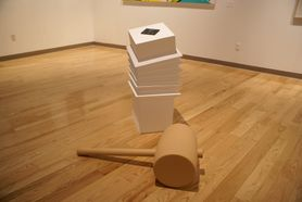 stacked boxes and huge mallet on gallery floor