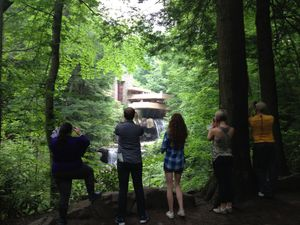 students looking at falling water