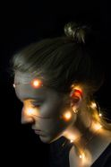 women's head wrapped with colored lights