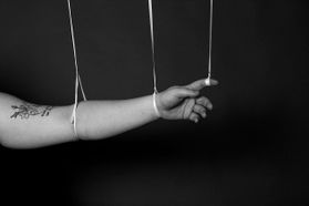 an arm being held up by string
