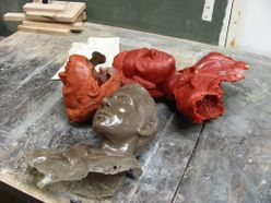 pile of busts on table
