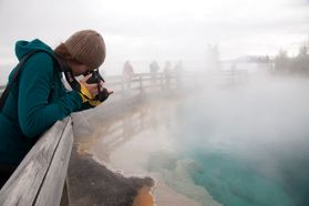 student taking photo of hot springs