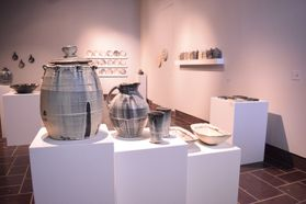 ceramics on pedestals in gallery