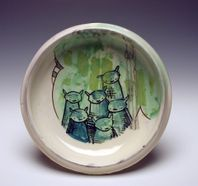 ceramic plate with cartoon bears painted on it